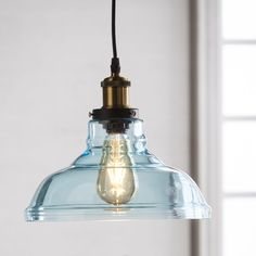Catch your eye on the brilliantly colored hand-blown glass on this downlight Inverted Pendant lamp. Translucent, soft aqua glass fashions a stacked bell shade, spotlighting an open filament Edison bulb. Coastal Lighting, Farmhouse Lighting, Home Lighting, Coastal Decor, Kitchen Lighting, Coastal Entryway, Coastal Furniture, Modern Coastal, Island Lighting