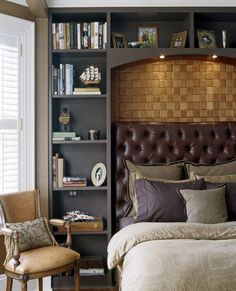 Love this masculine bedroom, warm hues, with built in bookcases around upholstered leather headboard.