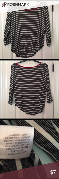 Pink Rose striped top. Size Medium. Black and white striped top with hot pink collar. Extremely soft. Pink Rose brand. Perfect for skinny jeans, flare jeans, yoga pants or as a pajama top! Size medium. Top is high low. In great condition! Pink Rose Tops