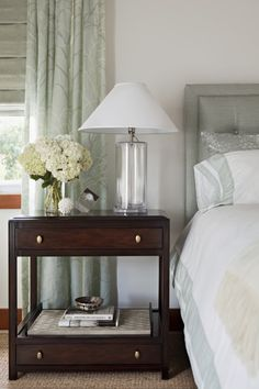 Houzz Tour: Nantucket-Inspired Craftsman in Venice Beach  The colors in this room were based on natural blue, white and beige hues that can be found at the nearby beach. Natural fabrics and materials continue this theme in the room's accessories.    Table lamp: John Saladino  Side tables: Mitchell Gold