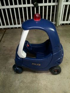 Police Car.  Cozy Coupe makeover. Painted blue and white. Added vinyl decal. Red warning light added to top.