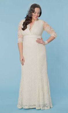 beautiful plus size lace wedding dress this says plus size but this company sizes start at 10.