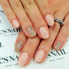 Pretty pink and sparkly nails.
