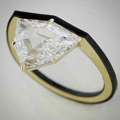 taffinjewelry Fancy shape diamond, gold and ceramic ring.