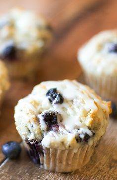 Blueberry Muffins with Lemon Glaze - This super-moist blueberry muffins recipe is a keeper. from @dearcrissy