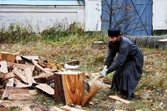 Monk cutting wood