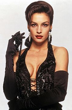 Xenia Onatopp (Famke Janssen) GoldenEye 1995 The last of the suggestive names! She's the first Bond girl of the Brosnan era, and a villain with a sadistic sexual appetite, able to kill with the power of her thighs. She's also one of two Bond girls who were also X-Men.