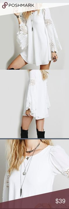 NWT White Poly Top / Dress Lace Inset Edged Sleeve Gorgeous White lightweight poly loose shift mini dress or long Tunic Top. Bell sleeves edged in Lace with lace Inset on arm. Please carefully  note measurements before purchasing. Total length 34 in. Across chest 22 in. Sleeve from shoulder to hem 26 in. Favolook Tops Blouses