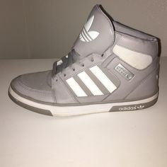 grey and white high top adidas