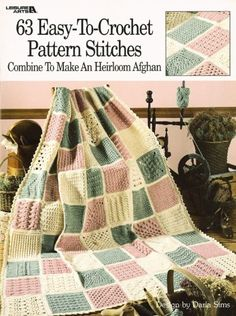 63 Easy-To-Crochet Pattern Stitches Combine To Make An Heirloom Afghan  (Leisure Arts #555) by Darla Sims,http://www.amazon.com/dp/1574866346/ref=cm_sw_r_pi_dp_Fb-ktb0Y1W7MSZWJ