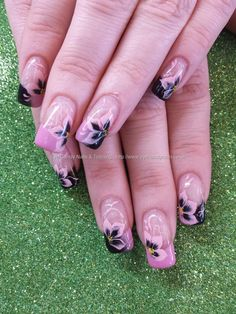 Pink and black gel polish with freehand one stroke flower nail art