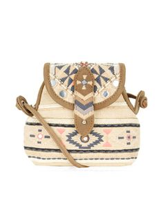Rock those tribal vibes with our Sansa mini pouch bag, decorated with embroidered patterns, mirrorwork embellishments and beads.  Designed with suede-look trims, this eye-catching piece also has a bright lining and zip-top closure.