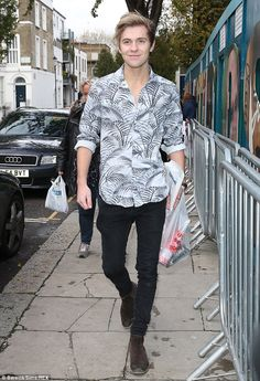 Oh boy: Only The Young's Mikey looked happy as he arrived in Notting Hill in a quirky shirt and skinny jeans