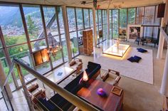 "The Heinz Julen Loft is a breathtaking Manhattan-loft-style chalet, built by  Heinz Julen , in his own unique style using steel, textured concrete, wood and floor to ceiling windows which flood the space with light.     The loft, is a two-floor, three bedroom loft .   ""The main living area has a suspended illuminated table which can be raised and lowered as required or lifted completely out of the way to ceiling height.  a fireplace, which is set into one of the glass walls."