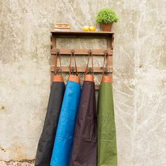 Handmade aprons made from waxed cotton and leather.
