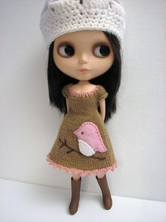 Black-haired Blythe in cream beret and brown corduroy dress.