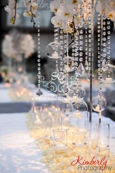 Suhaag Garden, Florida Indian Wedding Decorator, White Themed Wedding Reception, Curtis Hixon Park Tampa, Floating Candles, Acrylic Stands, Modern Wedding, Floating Candles, Drooping Crystals, White Orchids