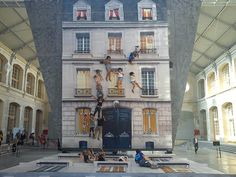 Leandro Erlich's Bâtiment. A gigantic mirror angled at 45 degrees gives the illusory effect of people dangling from ledges and climbing up the walls.