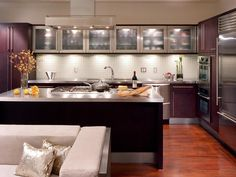 A pretty terrific kitchen layout and design.  Love the bank of opaque glass front brushed steel cabinets.