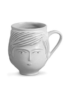 His and hers... this charming mug is feminine on one side boyish on the other.  Designed by Jonathan Adler and handmade by skilled craftsmen in his Aid to Artisans Peruvian workshop.