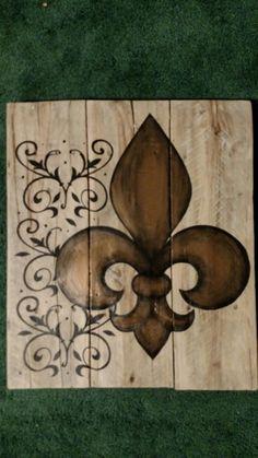 Copper fleur de lis painted on wood pallet board with swirls