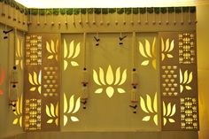 Traditional large lotus motifs interspersed with smaller clusters is subtly backlit with yellow light to form this backdrop for a wedding reception Wedding Stage Decorations, Engagement Decorations, Festival Decorations, Flower Decorations, Marriage Decoration, Altar Decorations, Ganapati Decoration, Decoration For Ganpati, Indian Decoration