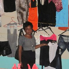 Enterprise Leader: Micilaine from Masson, Haiti, a graduate of New Missions, now she is a shop owner and sells clothes.