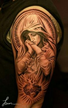 Jesus tattoo Catholic Church the Virgin Mary the Mother of God the Immaculate Conception Our Lady of Sorrows elbow arm shoulder prayer the Sacred Heart of Jesus rosary praying suffering