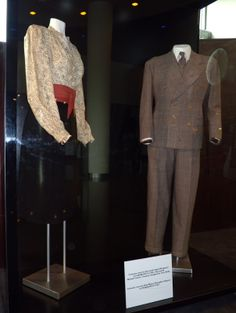 """Costumes worn by Ingrid Bergman and Humphrey Bogart in """"Casablanca"""" (1942) on display at the ArcLight Cinema as part of a retrospective celebrating the history of Warner Brothers Studios."""