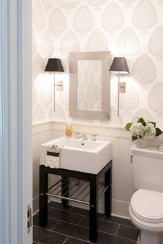 wall sconces that frame the vanity mirror... Small Bathroom Chic: Sophisticated Lighting from Bathroom Bliss by Rotator Rod