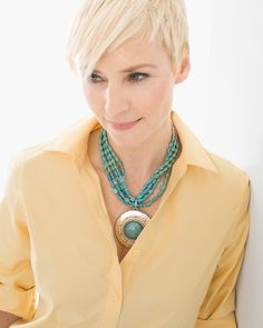 Instant, undeniable drama. This simulated-turquoise necklace works its charms with a hammered silver-tone medallion and carefully beaded details.    Metal, howlite, plastic, glass and other.  Imported.