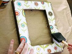 Scrapbook paper and decoupage on an old frame.  Careful not to put anything in it that needs preservation qualitymaterials
