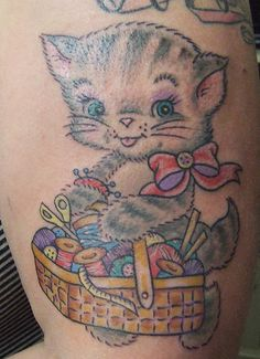 Sewing Kitty tattoo by [Kittyrobot] jodie this site has loads of fiber arts tattoos, you best go there your own self!