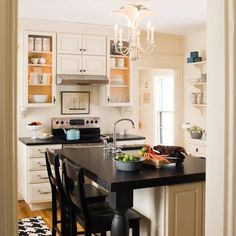 Although this is a rather small kitchen, I feel that it would fulfill every food eating/making need I have.  Plus I love the cabinets and black countertops with the cream.  yay:)