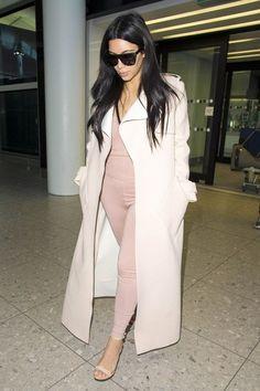 kim kardashian tight pink jumpsuit london heathrow airport june 2015