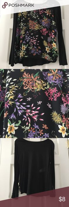 Forever21 black and floral top Small Forever21 black top with floral print in front. Front of the top is blouse material. These are two tiny holes on left arm, not noticeable, see in photos. Tops