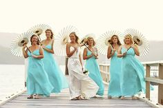 turquoise bridesmaids dresses + parasols