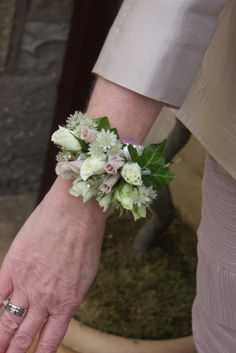 wrist Corsage of Astrantia, Snowflake Rose Buds and Rolled Petals matched her ensmeble perfectly