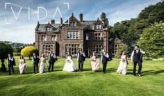 Bridal party strolling across the lawn at Buckland hall.