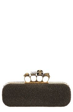 Alexander McQueen Knuckle Clasp Studded Box Clutch  A goldtone knuckle clasp, crowned with goth Alexander McQueen motifs and sparkling Swarovski crystals, tops a studded clutch wrapped in calfskin leather.