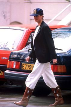 APRIL 1989 - She wore a pinstripe blazer with a baseball cap and track pants tucked into boots when she took Prince Harry to school.
