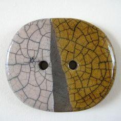Raku ceramic button in orange, white and black (oval) by Jude Allman, via Flickr
