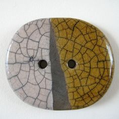 Raku ceramic button in orange, white and black (oval) by Jude Allman, via Flickr