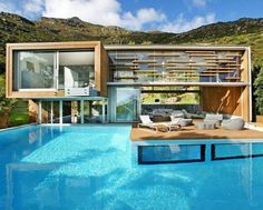 this is my kinda house! a whole bunch of pool and some house attached!