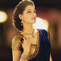 I really want a #sari like this. It's glitzy, #glamorous and the royal blue tones down the shine of the golden blouse.