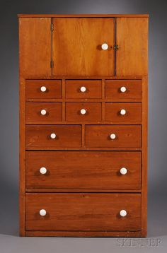 Shaker Pine Cupboard over Ten Drawers, Enfield, Connecticut, c. 1870, porcelain knobs, 69 H. x 39 W. x 17.5 D.