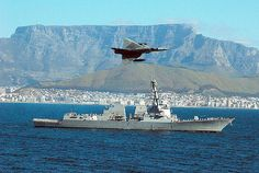 A South African Cheetah fighter jet flies over guided-missile destroyer USS Forrest Sherman (DDG as the ship departs after participating in the Southeast Africa Task Group first deployment to the region Military Jets, Military Aircraft, Fighter Aircraft, Fighter Jets, Jet Fly, South African Air Force, Falklands War, Navy Ships, Water Crafts