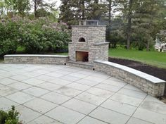 Outdoor Fondulac Stone Fireplace and pizza oven traditional-firepits