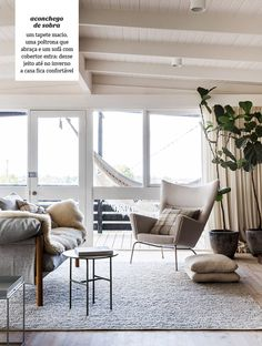 Love the hammock and touch of greenery in this neutral living room