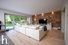 Contemporary House Extension RIBA Architects in Altrincham Cheshire. Contemporary House Extension RIBA Architects in Altrincham Cheshire. Brick Feature Wall, Feature Wall Living Room, My Living Room, Brick Wall Tv, Living Room Brick Wall, Brick Wall Kitchen, Large Open Plan Kitchens, Open Plan Kitchen Living Room, Open Plan Living